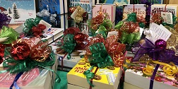 small bundles of books wrapped up with festive bows
